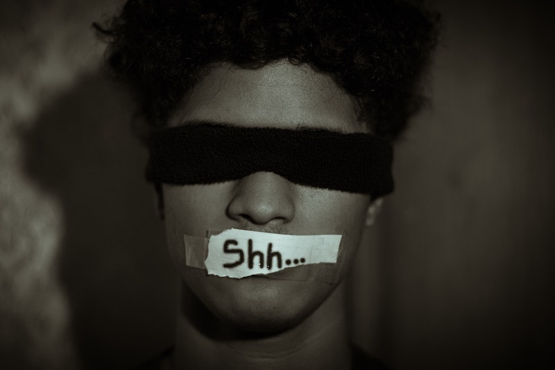 On dissent: Winter 2021 Edition call for contributions - Image of man with blindfold and mouth covering that says 'shh'